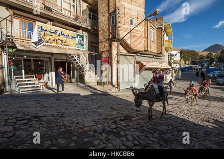 People riding on donkeys; Kandovan, East Azarbaijan, Iran - Stock Photo
