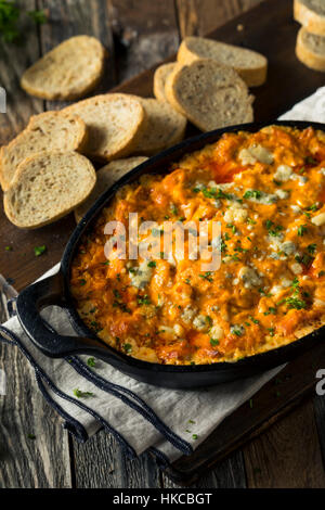 Homemade Buffalo Chicken Dip with Cheese and Crostini - Stock Photo