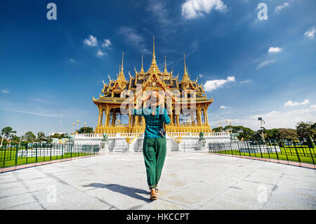 Woman in hat and green checked with photo camera going to the Ananta Samakhom Throne Hall in Thai Royal Dusit Palace, - Stock Photo