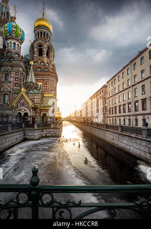 Church Savior on Spilled Blood Saint at Griboedov river and sunset sky in Petersburg, Russia - Stock Photo