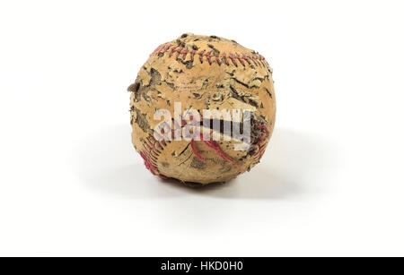 An old baseball that has seen better days. Torn stitches, Discolored leather ripped and torn sitting on a clean white background.