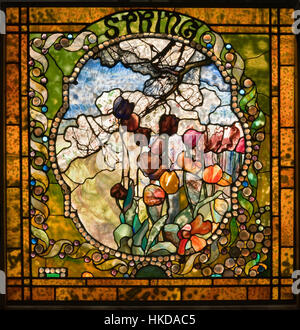 Spring panel from the Four Seasons leaded glass window by Louis Comfort Tiffany - Stock Photo