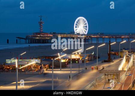 Beach boardwalk on the pier at night, Scheveningen, The Hague, Holland, The Netherlands - Stock Photo