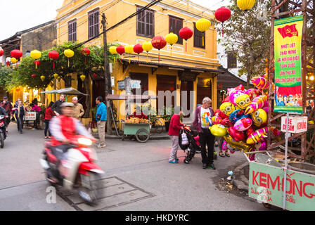 Hoi AN, VIETNAM - FEBRUARY 7, 2016: A motorbike, captured with blurred motion, rushes in the street of Hoi An old - Stock Photo