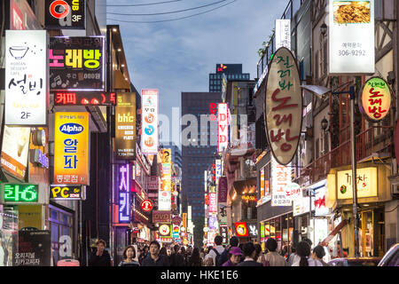 SEOUL, SOUTH KOREA - SEPTEMBER 12 2015: People wander in the walking streets of the Myeong-dong shopping district - Stock Photo