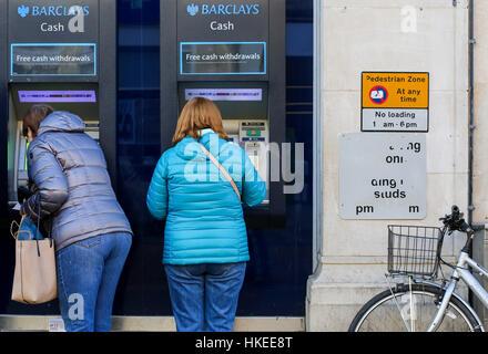 Cornmarket Street, Oxford, United Kingdom, January 22, 2017: Customers using a Barclays Bank ATM Bancomats Free - Stock Photo
