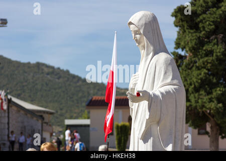 MEDJUGORJE, BOSNIA AND HERZEGOVINA, 2016/08/20. The statue of Virgin Mary in front of the church of Saint James. - Stock Photo