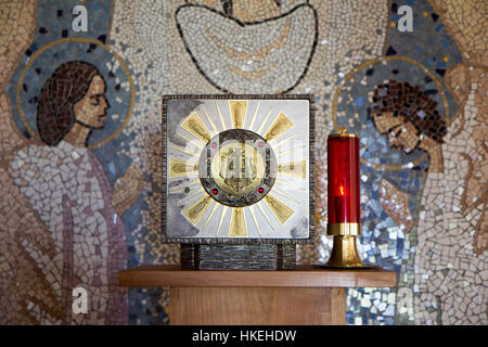 Medjugorje, Bosnia and Herzegovina 2016/11/13. Tabernacle with Eucharist and a sanctuary candle lamp in a chapel - Stock Photo