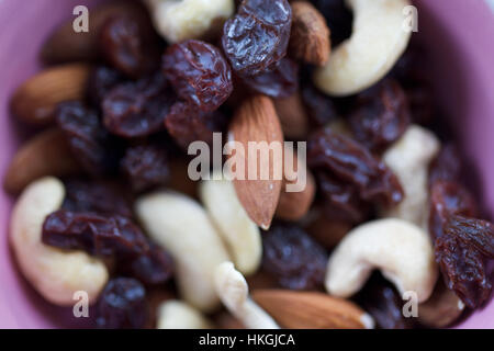 mixed dried fruit and nuts. almond, cashew, raisin, nutrition. - Stock Photo