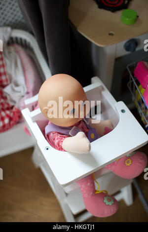 doll in baby chair. toy, children's room, figurine, childhood. - Stock Photo