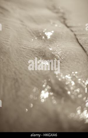 wet sand on beach. sand, texture, erosion, nature.. - Stock Photo