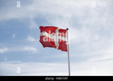 fluttering danish flag and cloudy sky. flagpole, patriotism, national flag, denmark. - Stock Photo