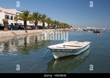 Palm lined promenade of fishing village known as capital of octopus (capital do Polvo), Santa Luzia, Algarve, Portugal, - Stock Photo