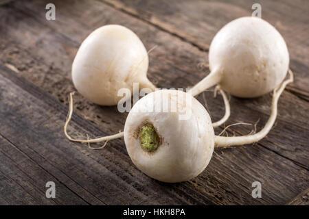 Turnip on wooden table - Stock Photo