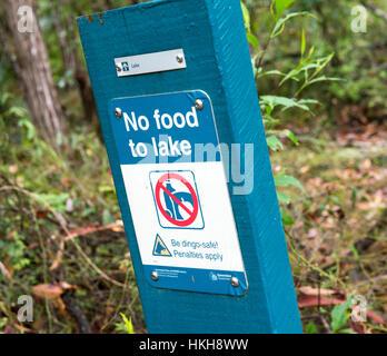 No Food to Lake warning sign at Lake McKenzie on Fraser Island, Queensland Australia - Stock Photo