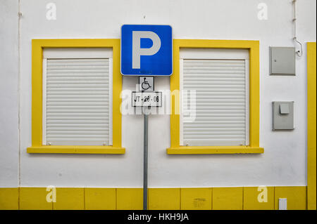 Disabled parking space outside a building - Stock Photo