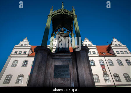 A statue to Martin Luther in front of the 'Rat' House in the Market Square of Lutherstadt Wittenberg,Saxony-Anhalt, - Stock Photo