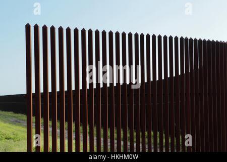 Border fence along the Texas-Mexico border near Brownsville, Texas. - Stock Photo