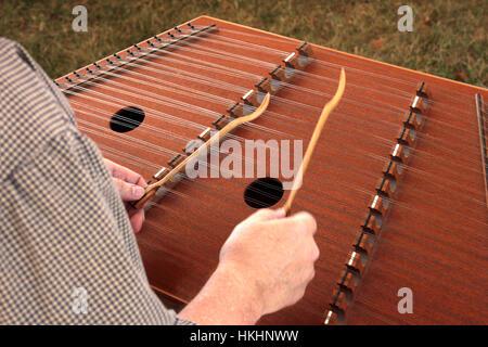 Playing the cimbalom - Stock Photo