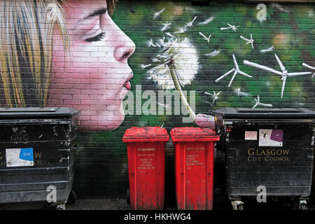 Girl blowing flower, Glasgow - Stock Photo