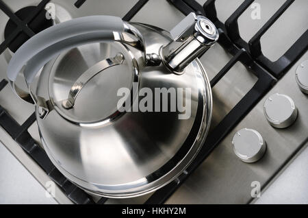 Tea kettle on gas stove. Top view - Stock Photo