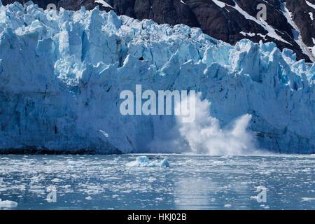 Calving Sawyer Glacier, Tracy Arm, Southeast Alaska; Alaska, United States of America - Stock Photo