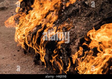 Natural gas fire which blazes continuously on a hillside, Yanar Dag, Absheron Peninsula; Baku, Azerbaijan - Stock Photo