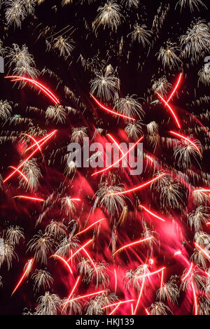 Red and white fireworks in night sky; Quebec, Canada - Stock Photo