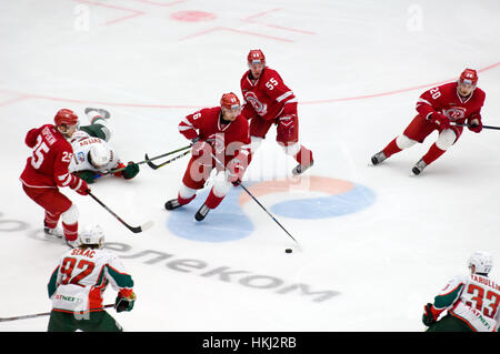 PODOLSK, RUSSIA - JANUARY 14, 2017: E. Katichev (26) dribble on hockey game Vityaz vs AKBars on Russia KHL championship - Stock Photo