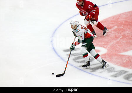 PODOLSK, RUSSIA - JANUARY 14, 2017: V. Tkachyov (55) dribble on hockey game Vityaz vs AKBars on Russia KHL championship - Stock Photo