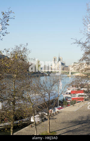 View down the Seine towards Notre Dame, Paris on a sunny winter's day - Stock Photo