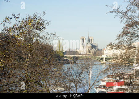 View down the Seine towards Notre Dame on a sunny winter's day, Paris., France - Stock Photo