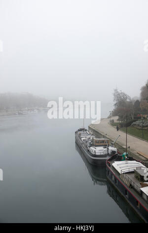 View of the Seine in the fog from the Pont de Sully, Paris, France - Stock Photo