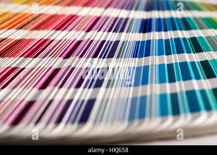 Close up selective focus shot of color sampler fan deck with shades of vivid colors. Background concept - Stock Photo