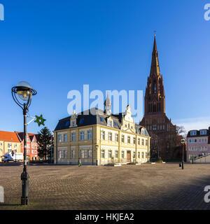 Hanseatic City of Demmin, town hall and church of St. Bartholomew, Mecklenburg-Pomerania, Germany. - Stock Photo
