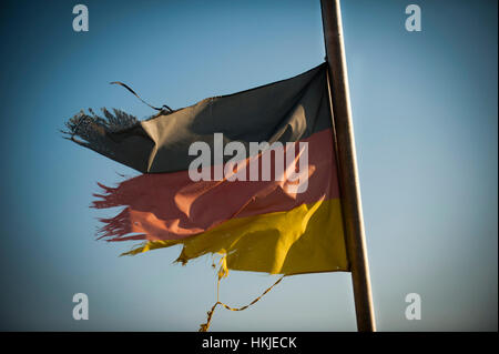 A battered and torn German Flag. - Stock Photo