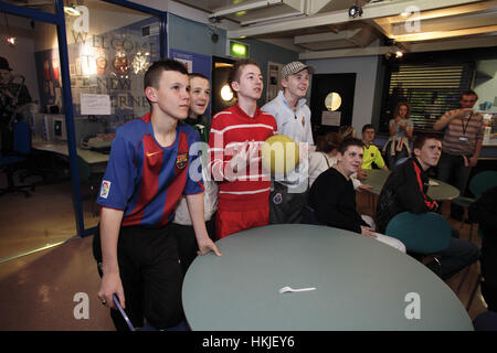 Youth in Castlemilk watch a TV programme about offending, crime and punishment - Stock Photo
