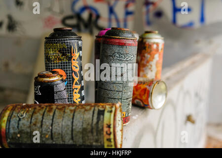 Empty aerosol cans discarded after being used to spray graffiti - Stock Photo
