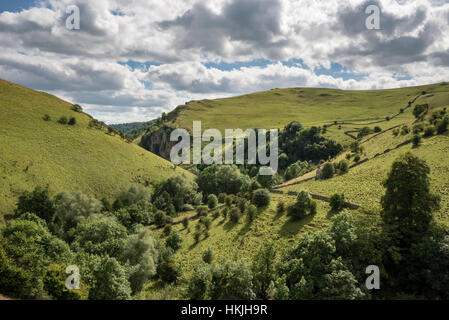 Beautiful scenery near Milldale in the Peak District national park. The steep slopes of Dovedale on a summer day. - Stock Photo
