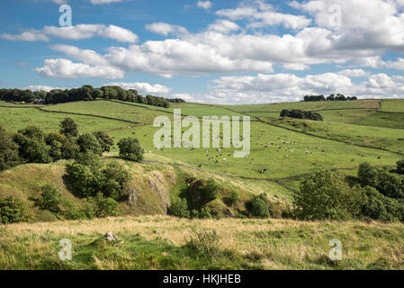 Beautiful summer day in the White Peak area of the Peak District national park, Derbyshire. View from hilltop above - Stock Photo