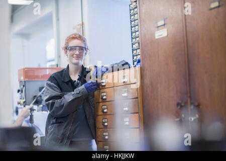 Portrait of a young female engineer standing in an industrial plant, Freiburg im Breisgau, Baden-Württemberg, Germany - Stock Photo