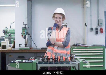 Young female engineer working in an industrial plant, Freiburg im Breisgau, Baden-Württemberg, Germany - Stock Photo