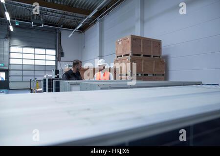 Store workers working in a distribution warehouse, Freiburg im Breisgau, Baden-Württemberg, Germany - Stock Photo