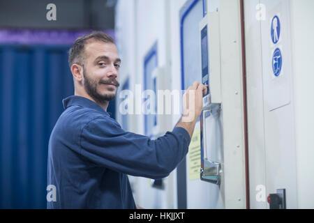 Portrait of a store worker working in warehouse, Freiburg im Breisgau, Baden-Württemberg, Germany - Stock Photo