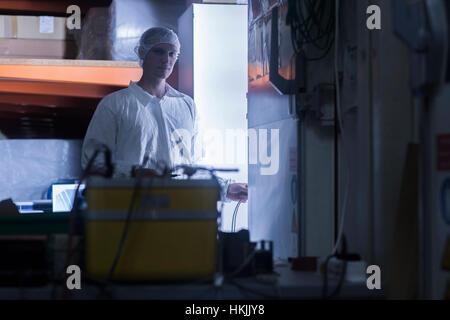 Clean room worker working in warehouse, Freiburg im Breisgau, Baden-Württemberg, Germany - Stock Photo