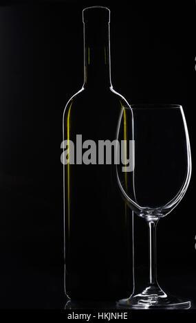 wine empty glass with bottle on black background - Stock Photo