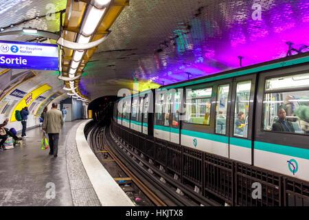 Train on platform on metro station in Paris, France. - Stock Photo