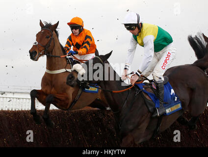 Many Clouds and Leighton Aspell (right) jump an early fence in company with Thistlecrack ridden by Tom Scudamore - Stock Photo