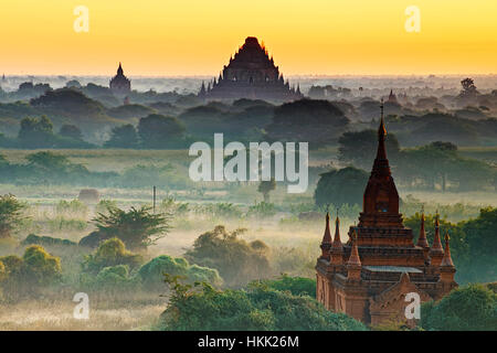 Scenic view of ancient Bagan temple during golden hour - Stock Photo