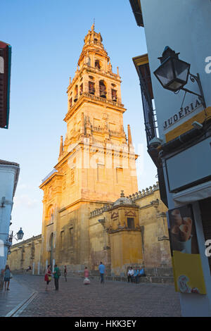 CORDOBA, SPAIN - MAY 26, 2015: The Cathedral tower in the evening light and walls. - Stock Photo